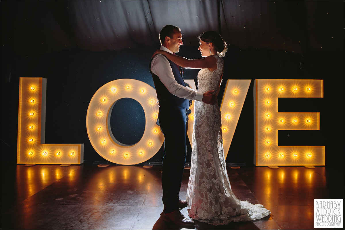 A first dance photograph with LOVE letters at Middleton Lodge in Yorkshire