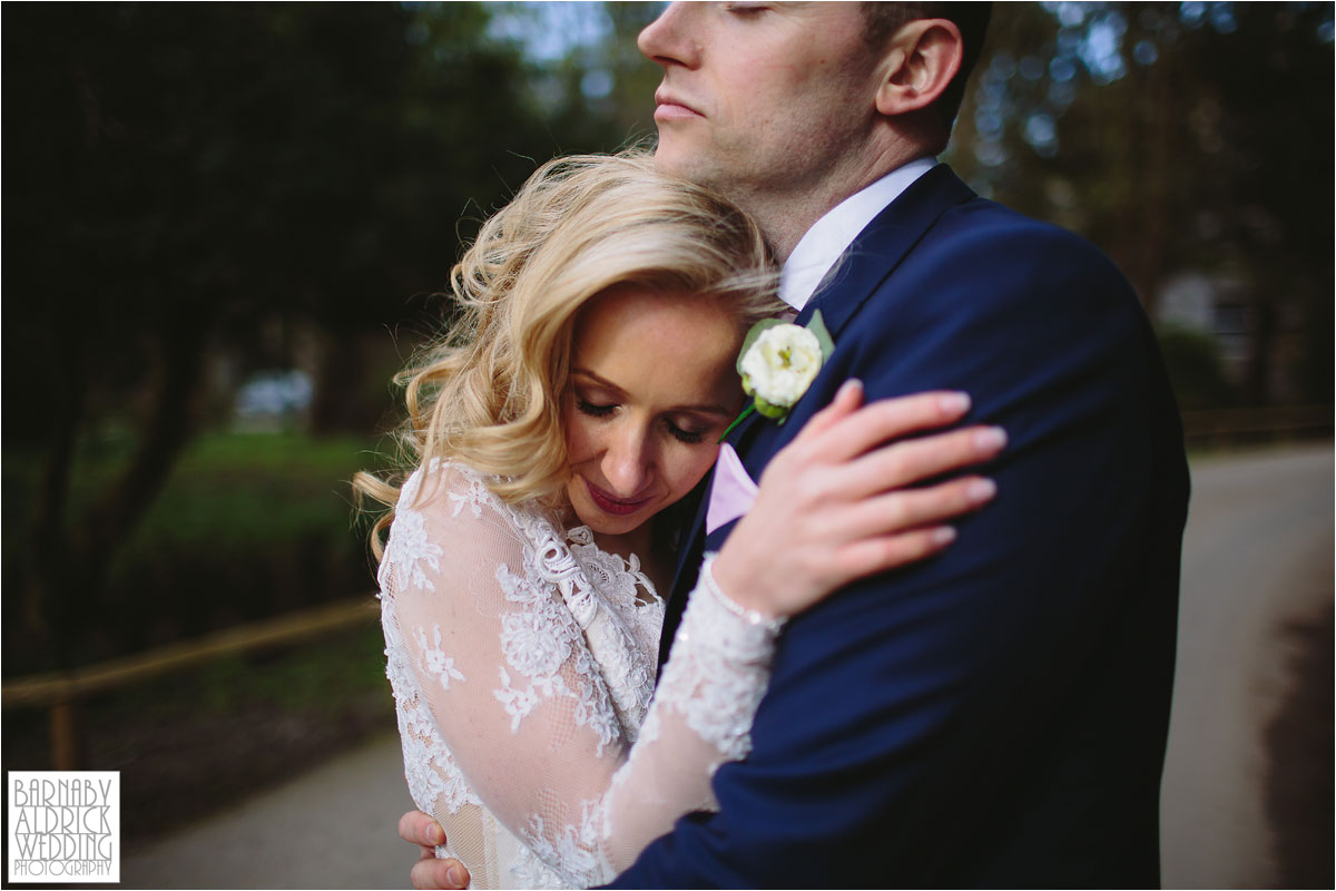 Wedding Photography of a couple cuddling outside the georgian country manor house at Middleton Lodge