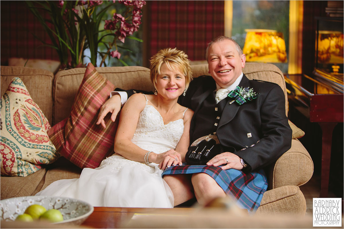 A wedding photo of a couple on a sofa at The Pheasant Hotel in Harome near Helsmley in North Yorkshire