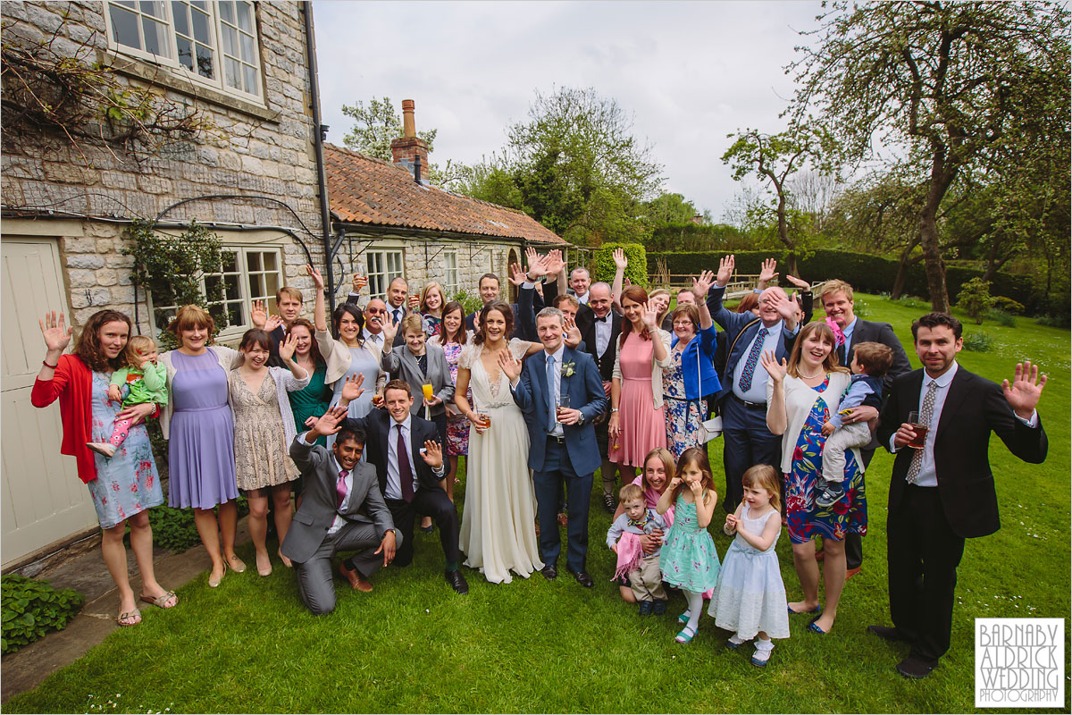 A wedding group photo at The Pheasant Hotel in Harome near Helsmley in North Yorkshire