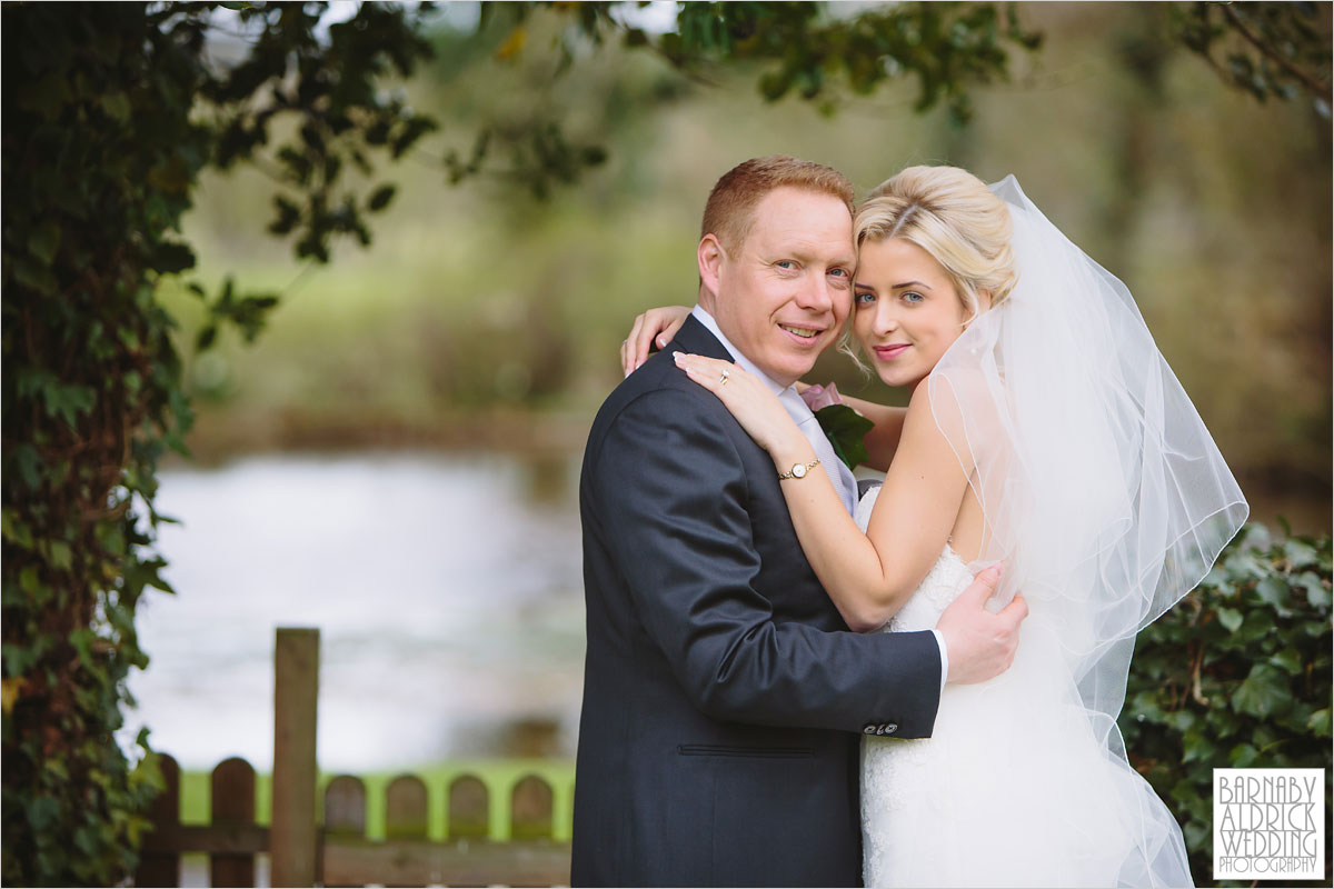 A wedding photo of couple in the gardens at The Pheasant Hotel in Harome near Helsmley in North Yorkshire