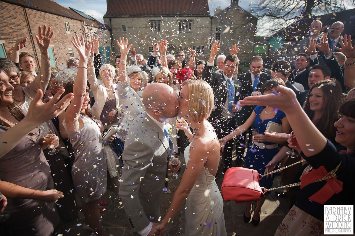 A wedding confetti photograph at Priory Cottages wedding venue near Tadcaster and Wetherby in Yorkshire