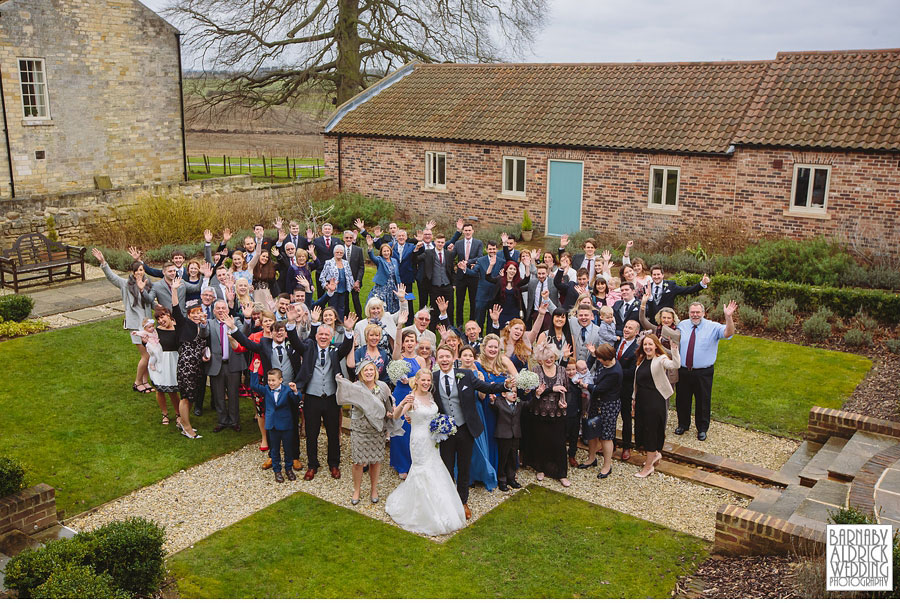 Fun group photograph at a wedding at Priory Cottages