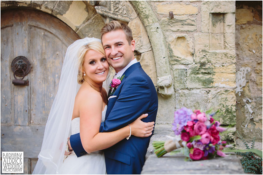 A wedding photograph of a couple embracing at Priory Cottages wedding venue near Tadcaster and Wetherby in Yorkshire