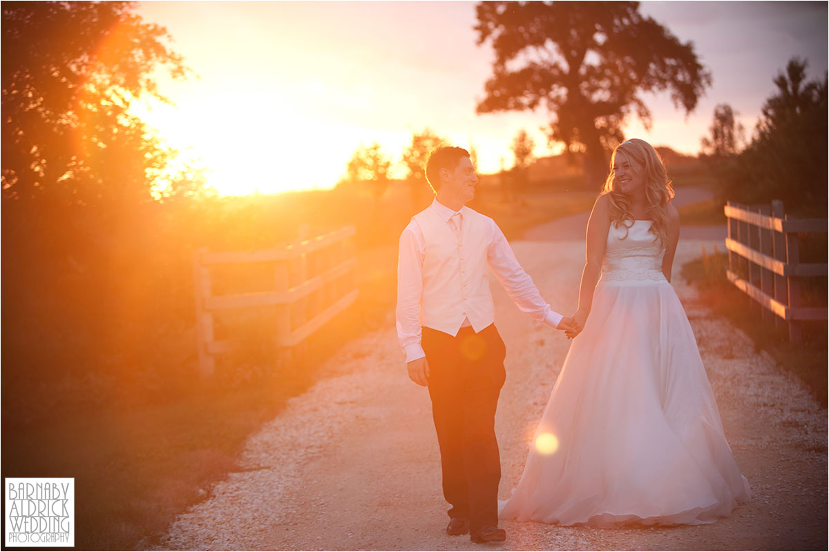 A sunset wedding photograph of a couple walking at Priory Cottages wedding venue near Tadcaster and Wetherby in Yorkshire