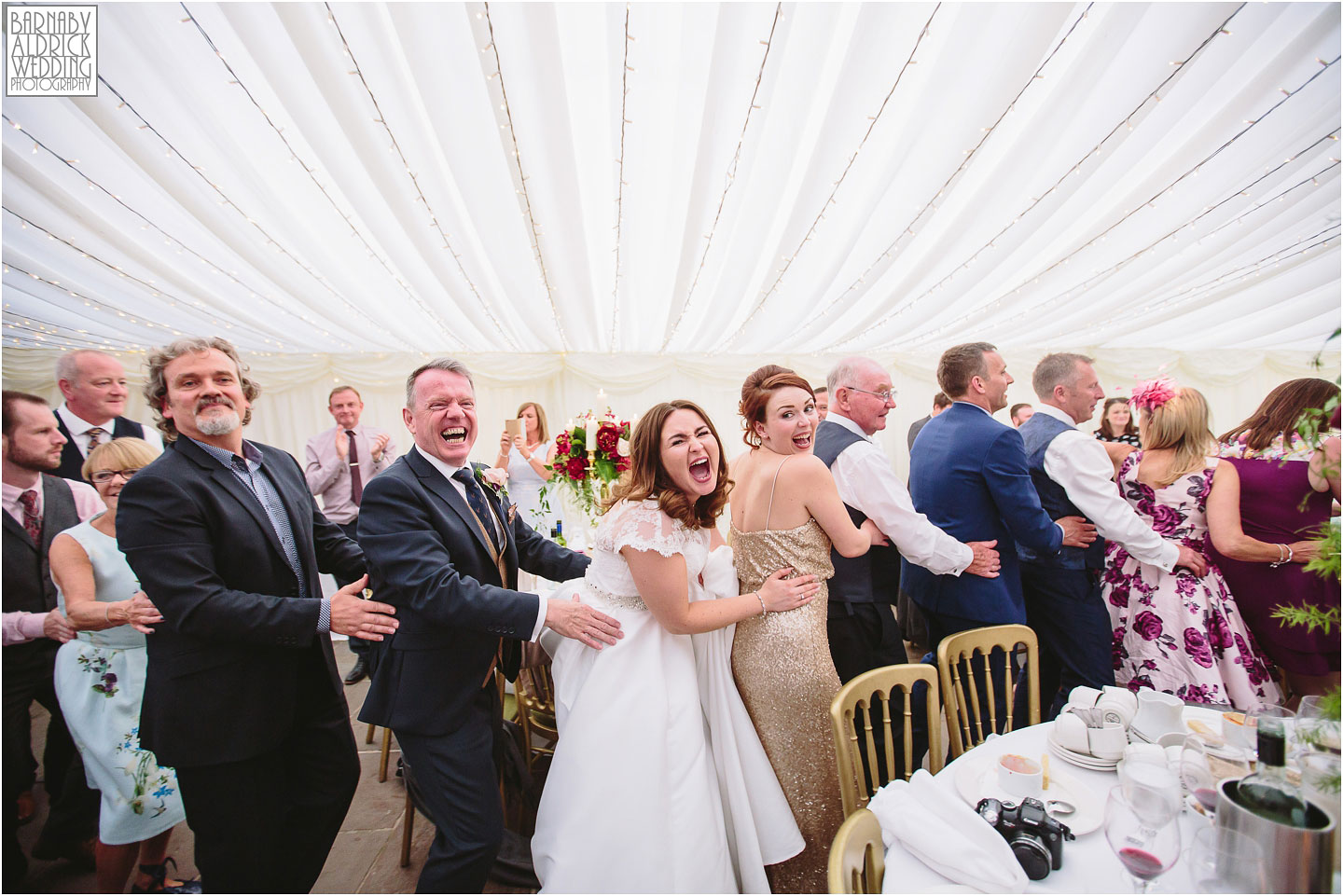 Conga Line at The Inn at Whitewell, Howard Wing MC, Lancashire wedding Photographer