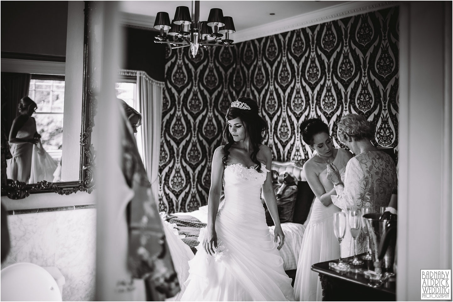 A wedding photograph of a bride getting ready at the boutique wedding venue Crab Manor near Thirsk