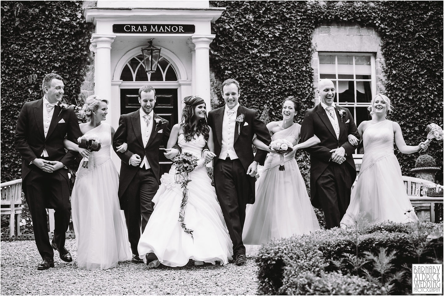 A fun and funky wedding party groupshot at the Crab and Lobster in Yorkshire