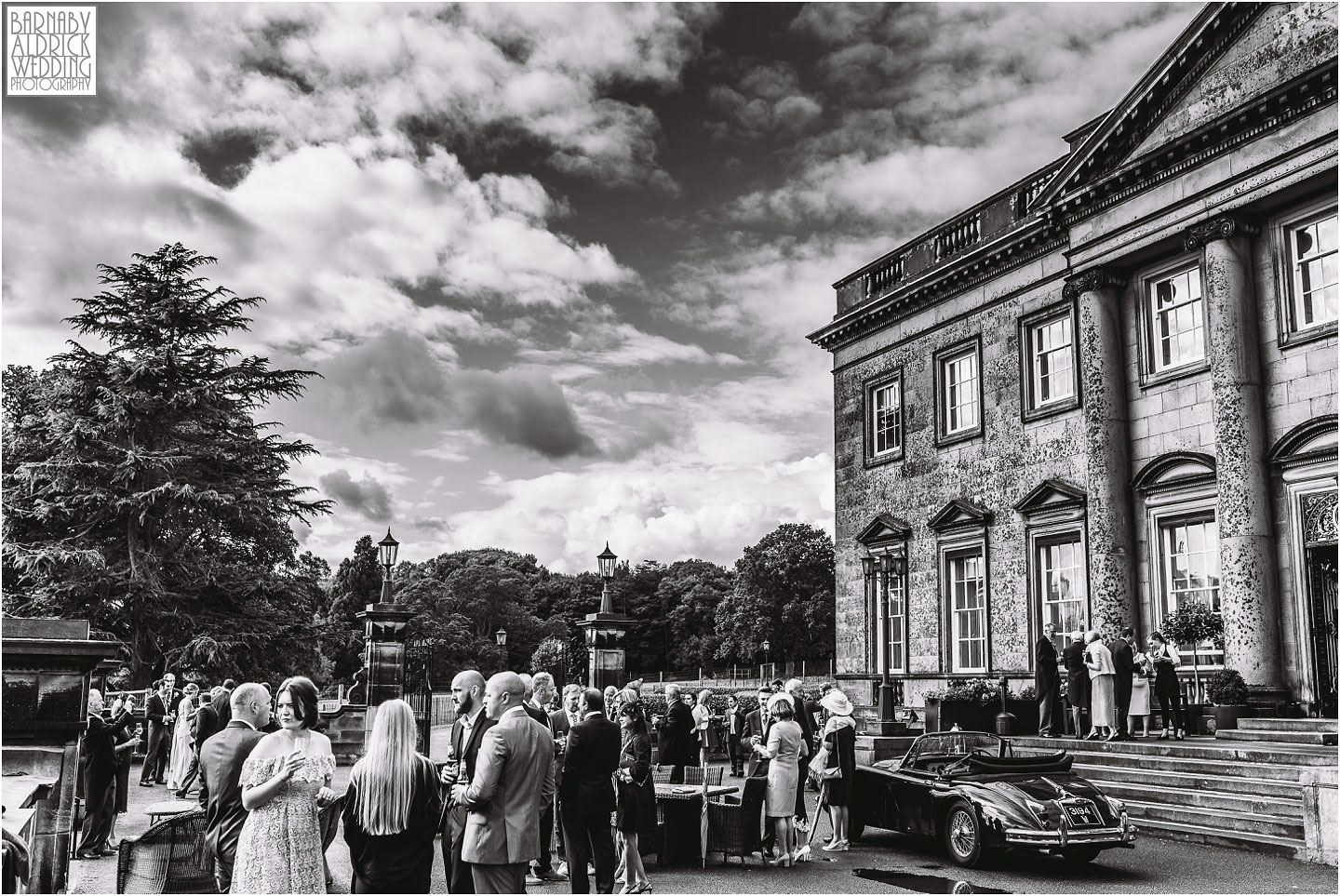 A Wedding photo of guests outside Denton Hall in Ilkley in Yorkshire