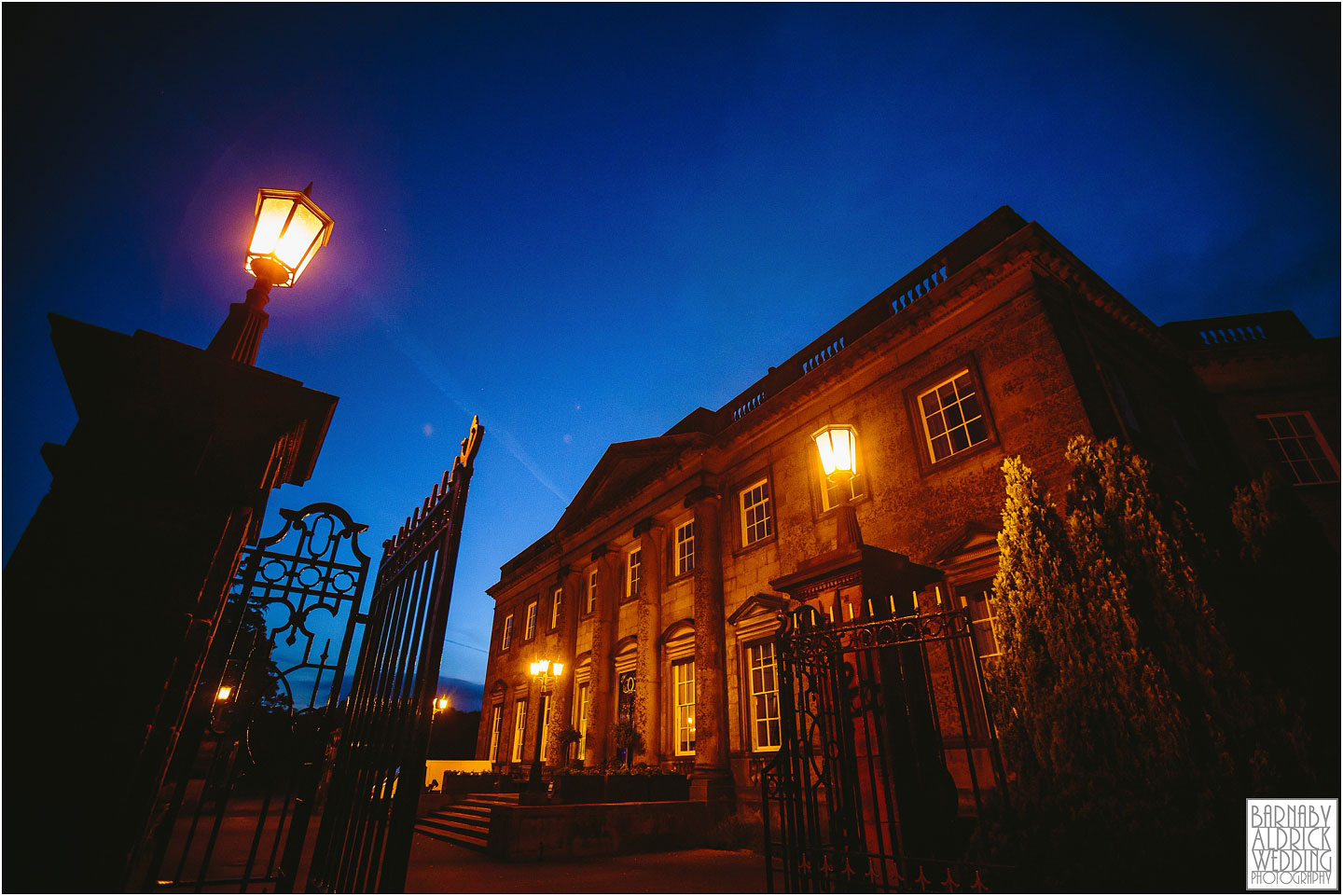A wedding photograph of Denton Hall at night near Ilkley