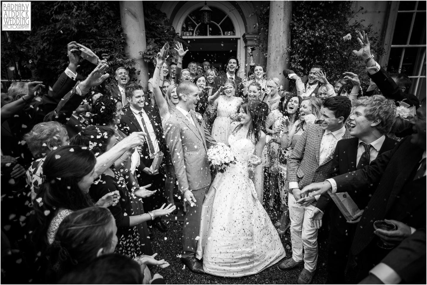 A confetti toss outside the listed country house at Middleton Lodge