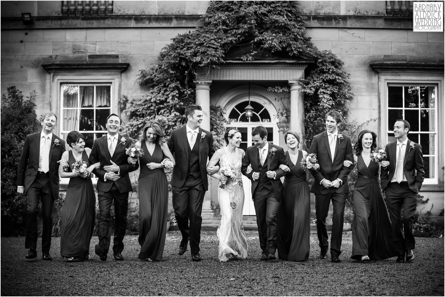 A fun photograph of the wedding party outside Middleton Lodge in North Yorkshire