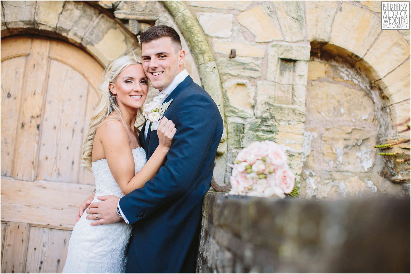 A beautiful wedding portrait outside syningthwaite priory at Priory Farm in Wetherby