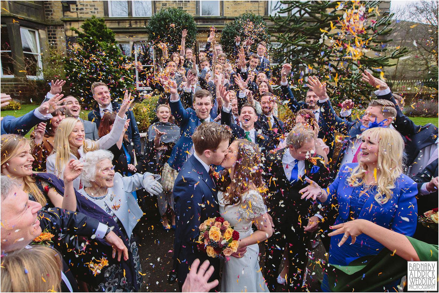 A Crow Hill confetti photograph in Marsden at a Spring Wedding at a West Yorkshire Country House by Photographer Barnaby Aldrick