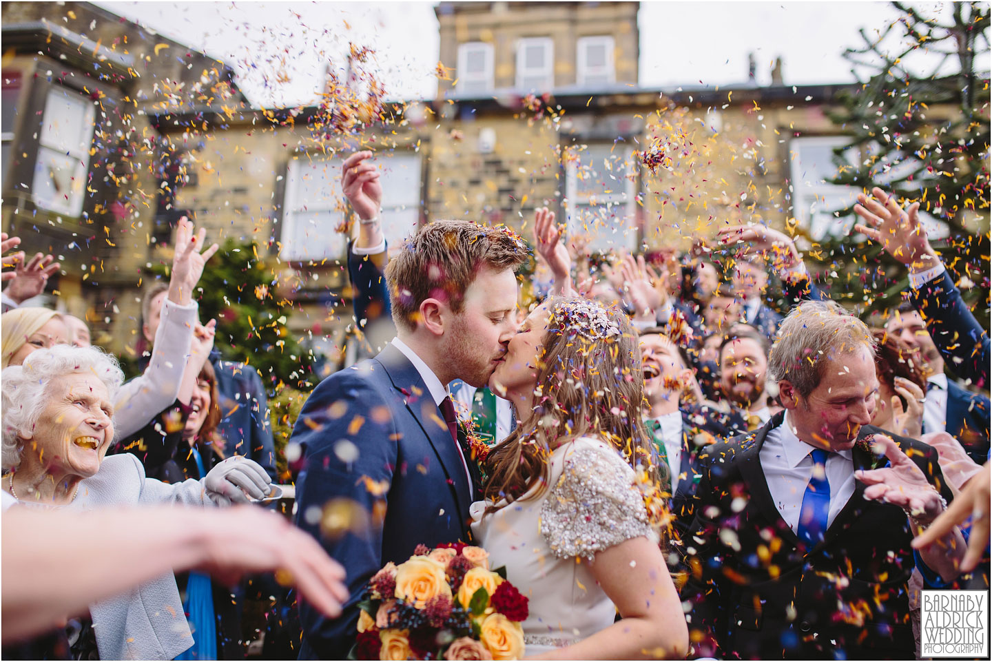 A Crow Hill confetti shot at a Spring ceremony at a Marsden West Yorkshire Country House by Photographer Barnaby Aldrick