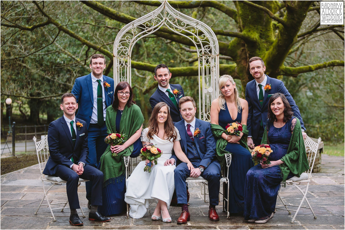 A fun wedding group shot at Crow Hill a Marsden West Yorkshire Country House by Photographer Barnaby Aldrick
