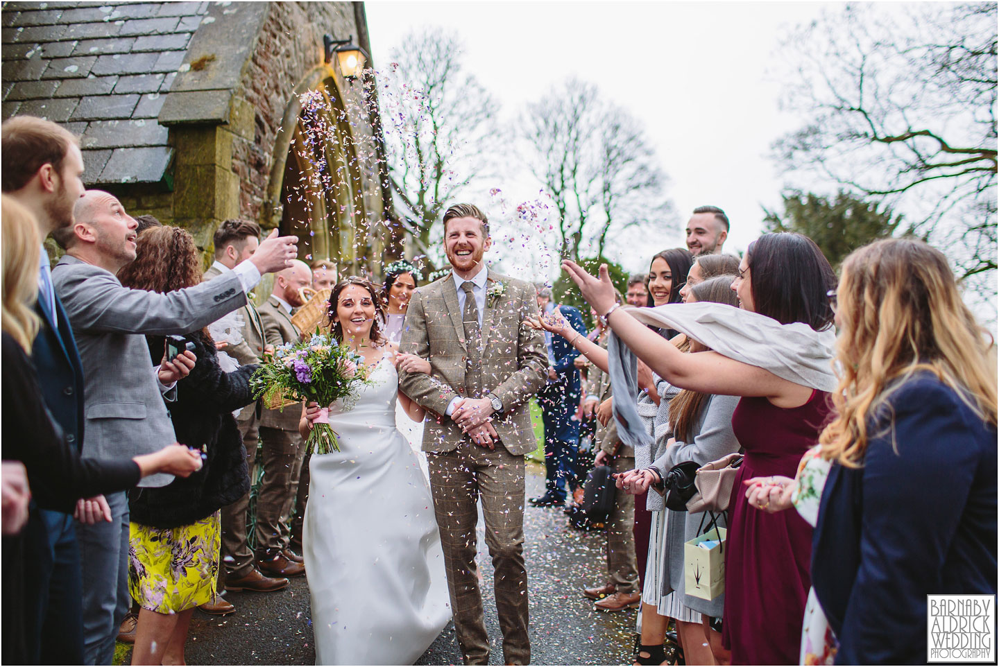 Confetti wedding photograph of a happy couple at Falcon Manor in Settle, Church confetti photo settle, Yorkshire Dales Wedding Photographs