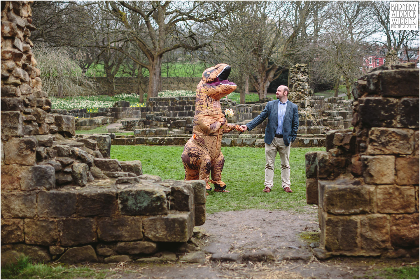 Dinosaur Fancy Dress Pre-Wedding Shoot, Dinosaur wedding outfit, Fancy dress engagement shoot ideas, T-Rex wedding outfit