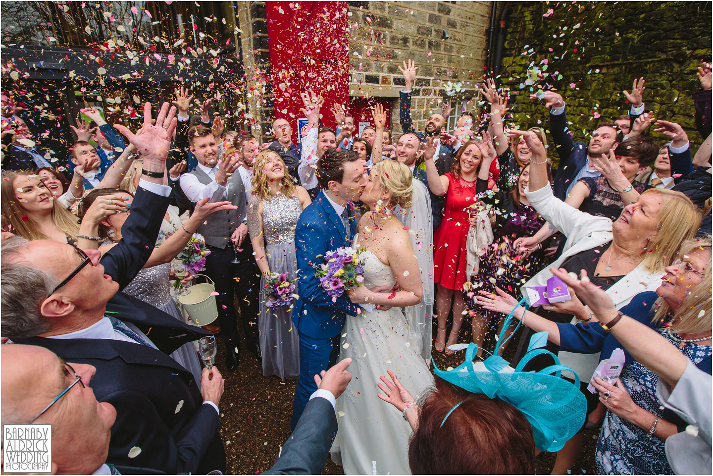Confetti wedding photograph of a happy couple at Standedge Tunnel and Visitor Centre in Marsden
