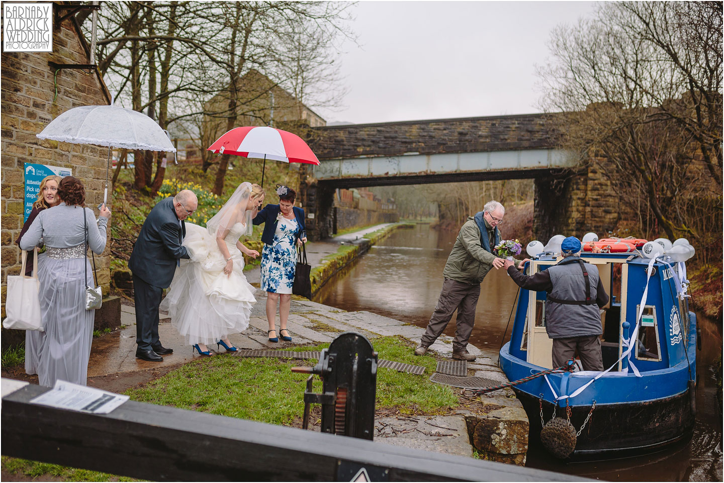 The bride boards a canal boat before going to her wedding at Standedge Tunnel and Visitor Centre in Marsden