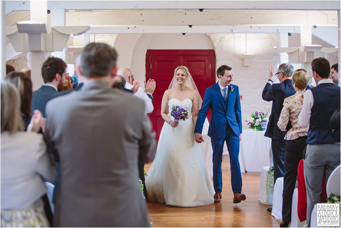 Walking down the aisle at a Standege Visitors Centre wedding in Yorkshire