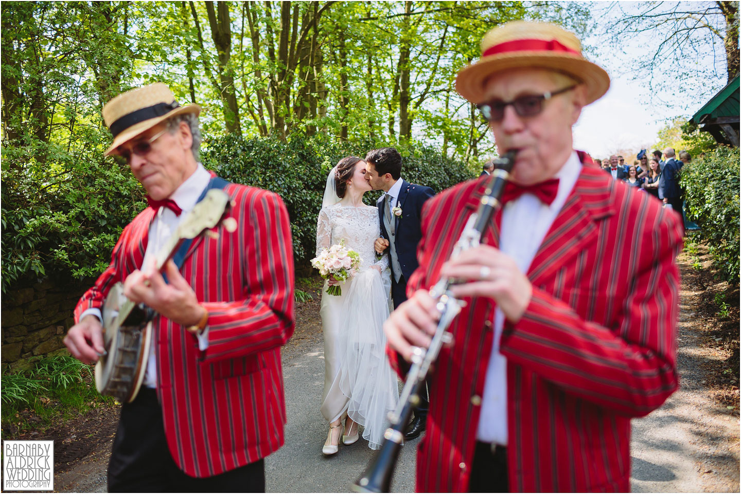 Yorkshire jazz band wedding procession, Denton Hall an exclusive country house in Ilkley in West Yorkshire