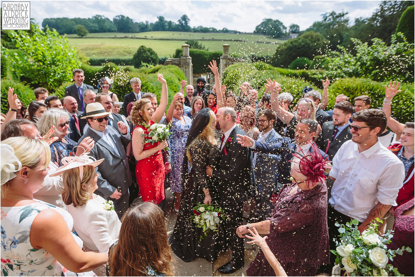 A wedding photo at Fountains Abbey of a confetti throw
