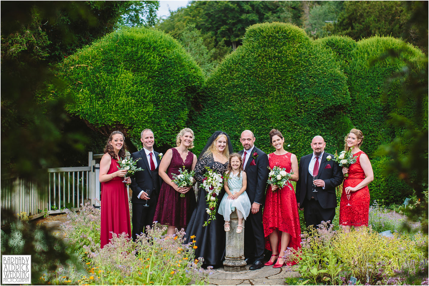 A wedding party group photo at Fountains Abbey Herb Garden