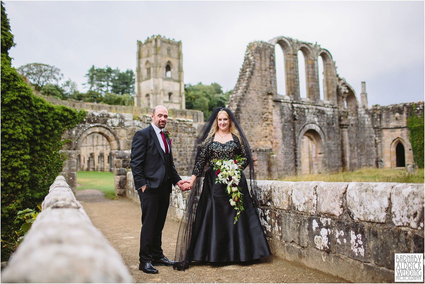 A wedding portrait photograph in the ruins of The National Trust's Fountains Abbey