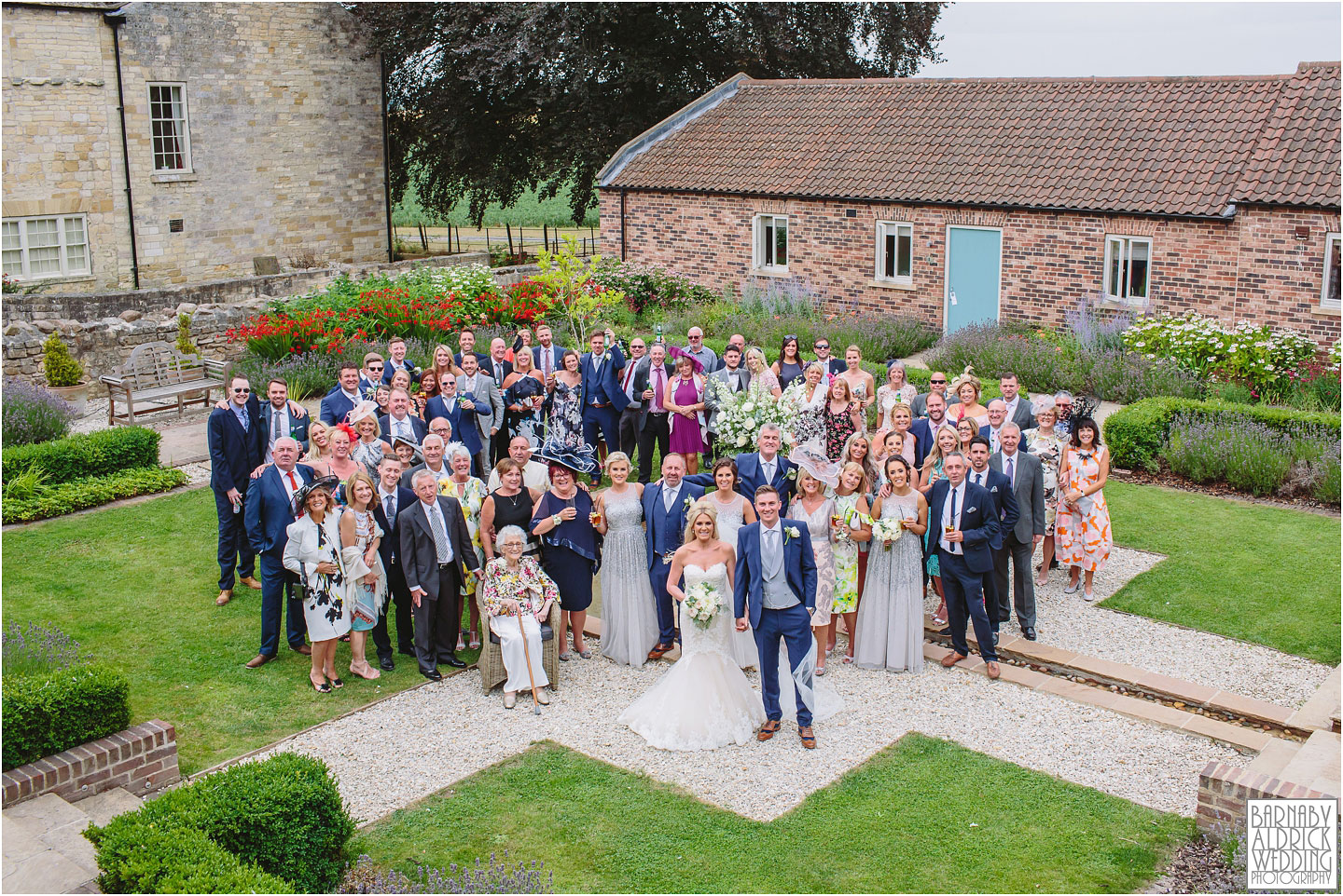 Wedding group shot photo at Priory Cottages Wetherby