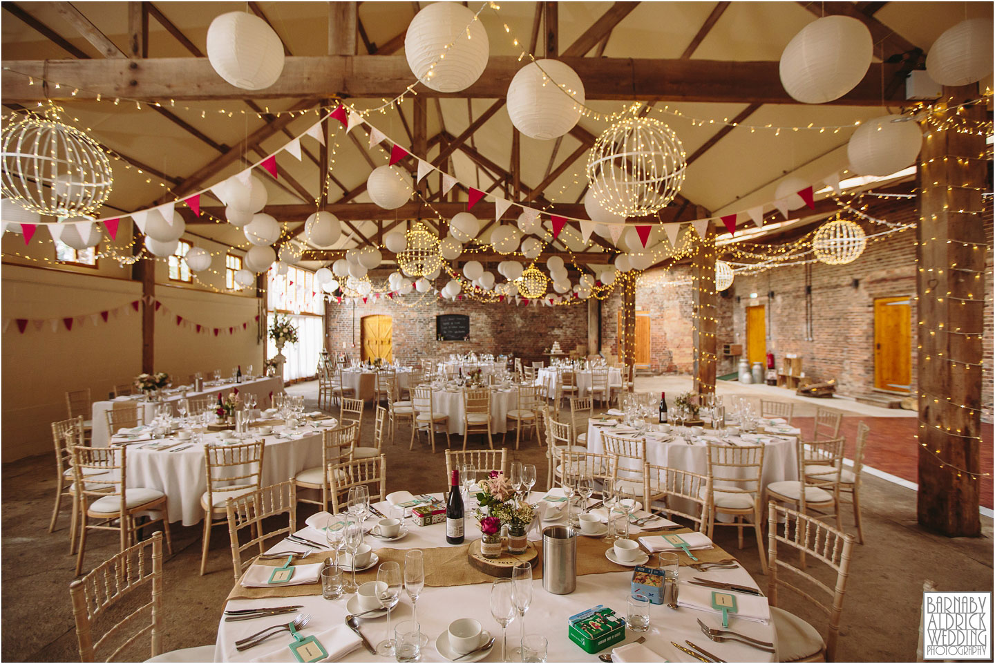 Wedding barn set for the wedding breakfast at Barmbyfields Barn wedding venue near York