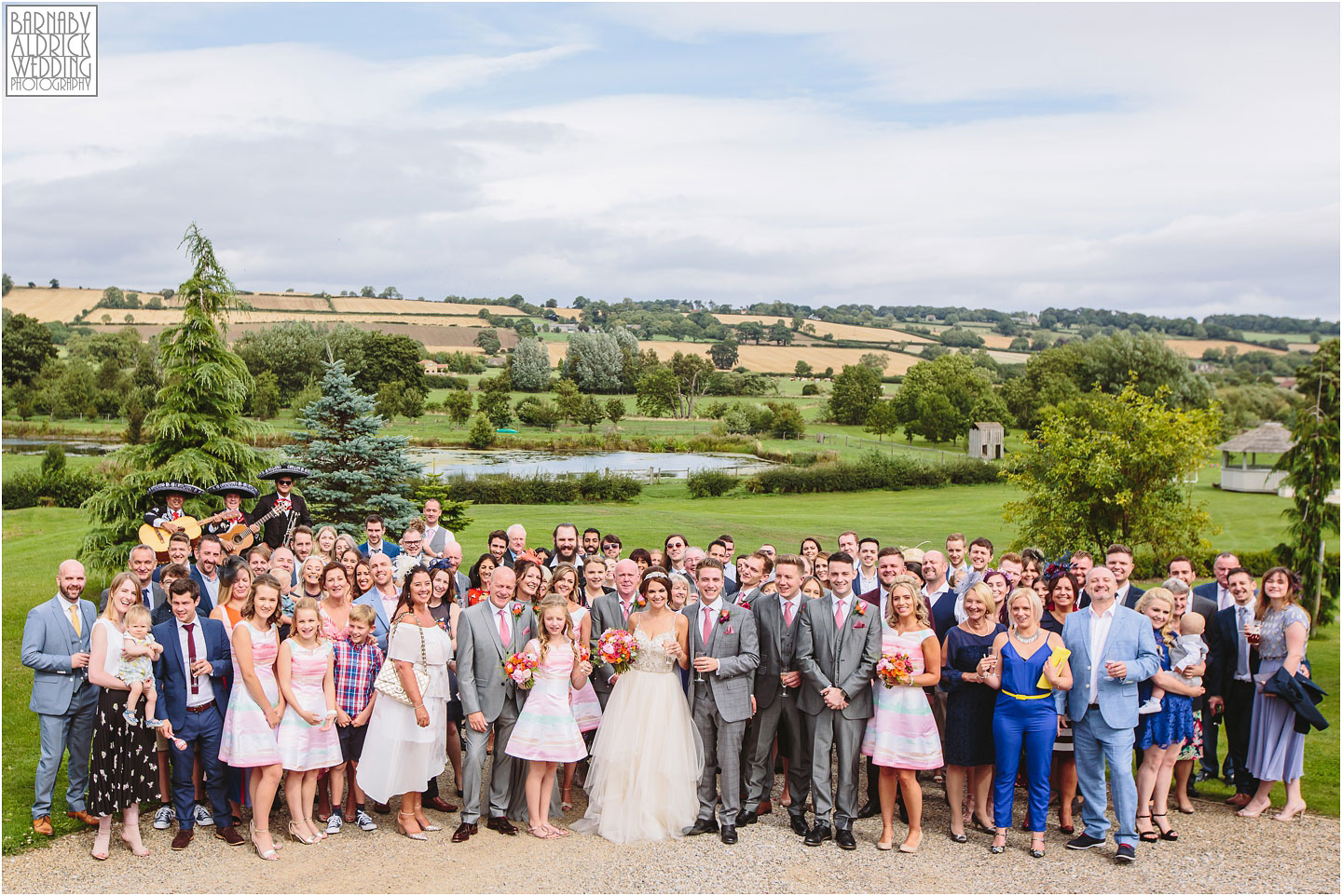 Group photo of all the guests at Yorkshire Wedding Barn near Richmond