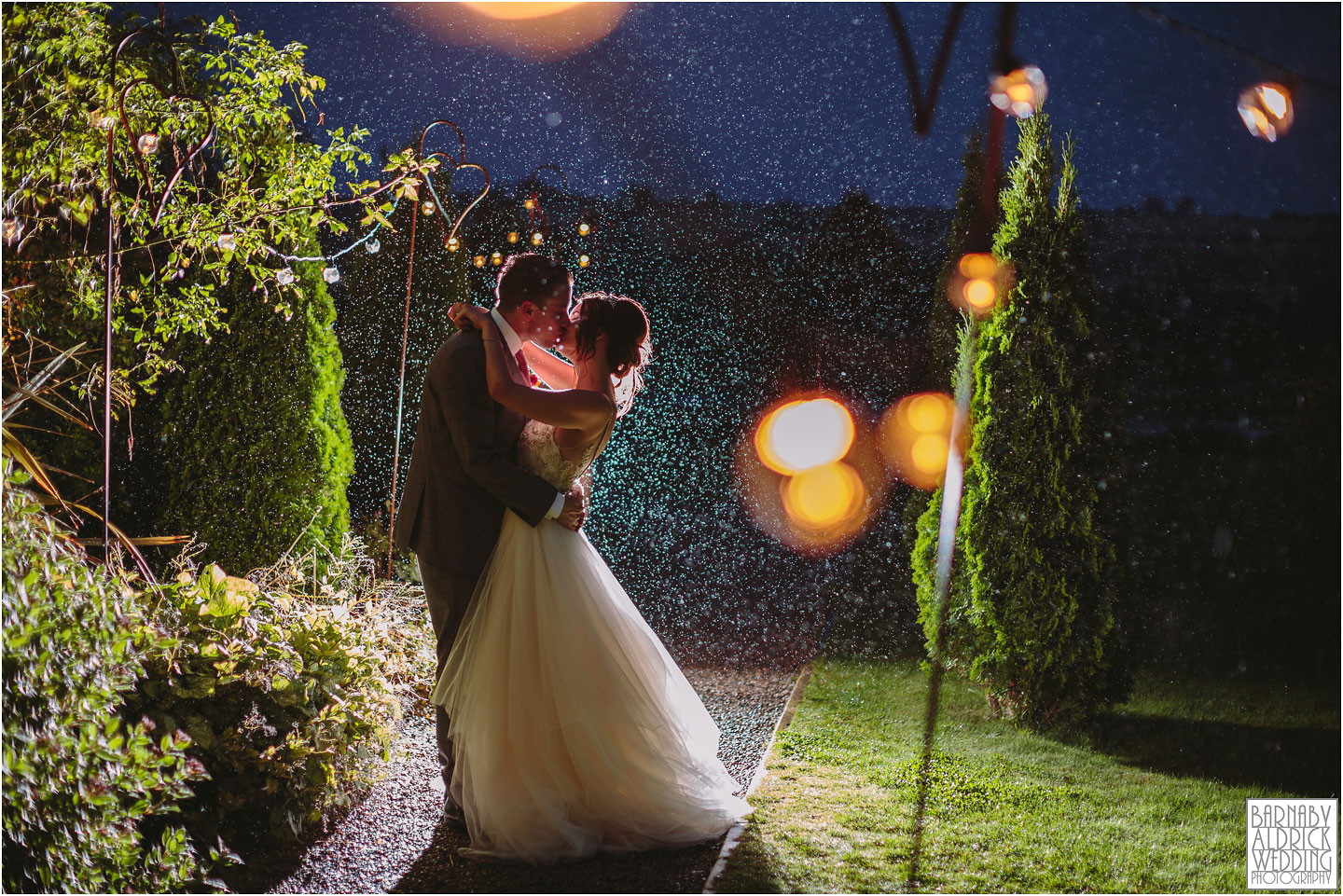 Backlit rain wedding photograph at Yorkshire Wedding Barn near Richmond in Yorkshire