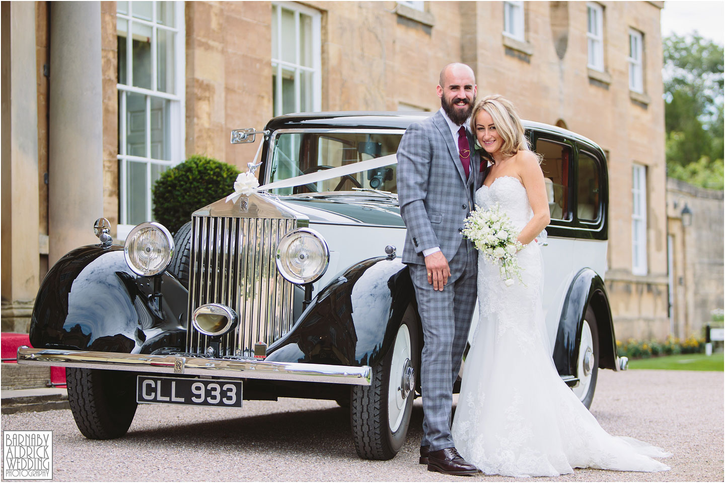 Bowcliffe hall wedding couple portrait photograph with rolls royce