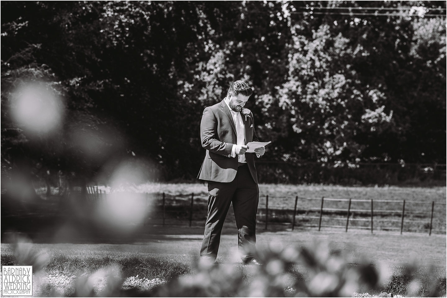 A nervous Groomsmen practices his speech at Saltmarshe Hall near Goole in East Yorkshire, Wedding photography at Saltmarshe Hall, East Yorkshire Wedding Photographer, outdoor sapphire Ceremonies in Yorkshire