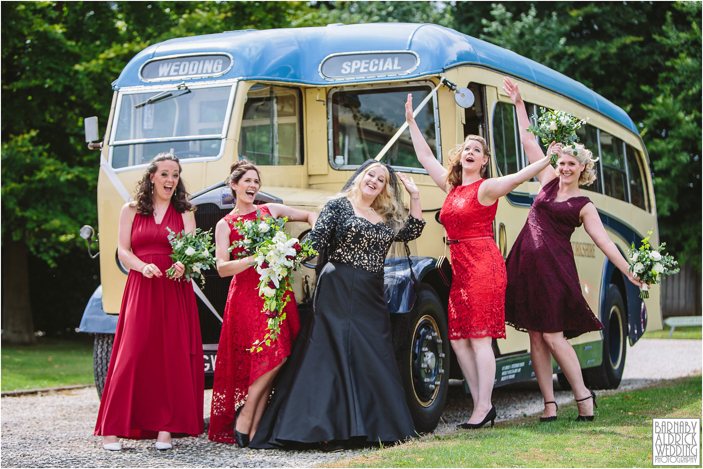 Fun photo of a bride in black wedding dress by a vintage bus, Amazing Yorkshire Wedding Photos, Best Yorkshire Wedding Photos 2018