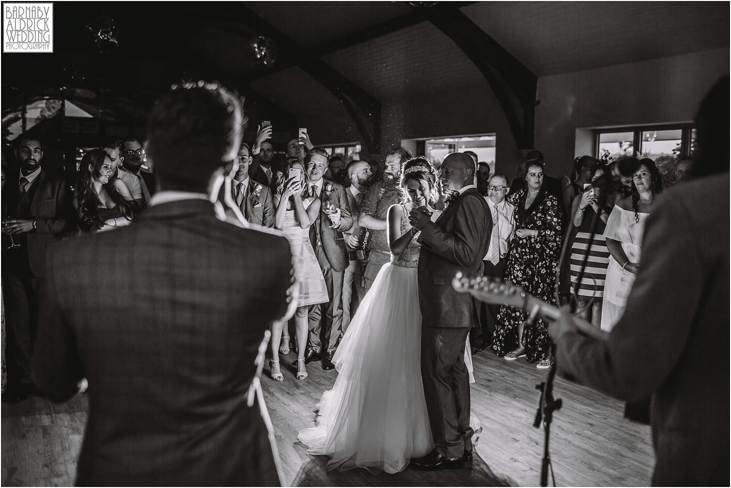 A groom sings while his wife dances at Yorkshire Wedding Barns, Amazing Yorkshire Wedding Photos, Best Yorkshire Wedding Photos 2018