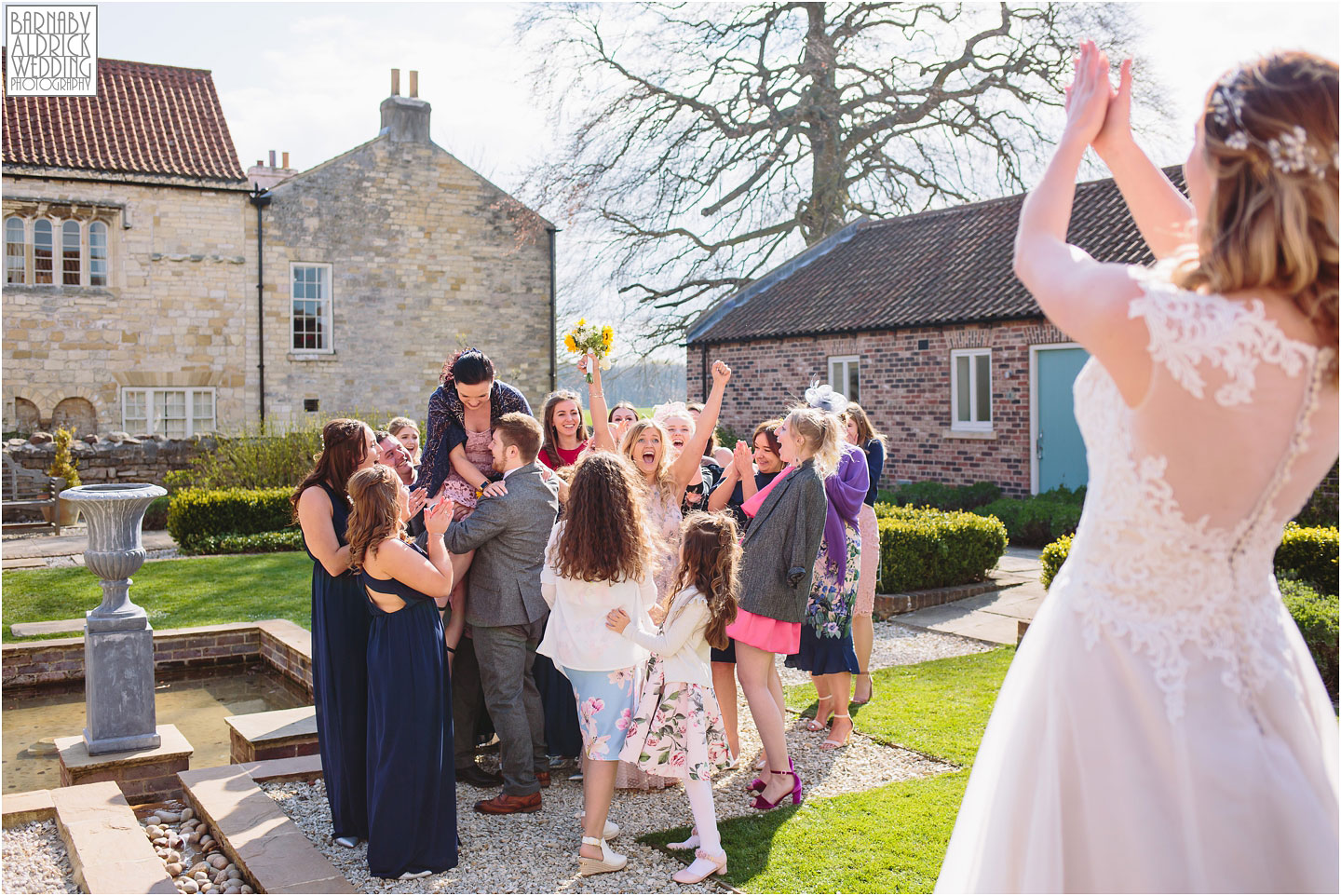 Amazing bouquet toss wedding photograph