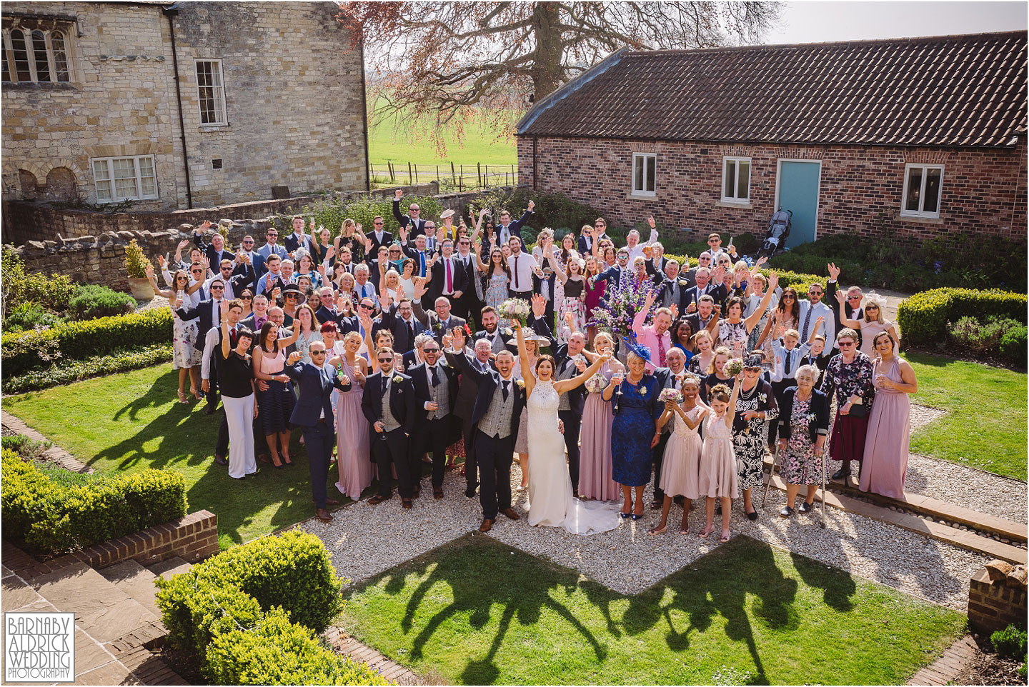 A photo of everyone at a spring wedding at Priory Cottages in Yorkshire, Priory Cottages Yorkshire, The Priory Syningthwaite, Yorkshire Barn wedding venues