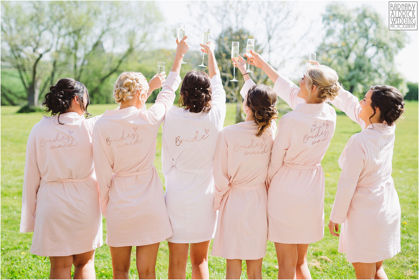 Bridesmaids toast photo, matching bridesmaids dressing gowns, Priory cottages Bridal preparations gowns