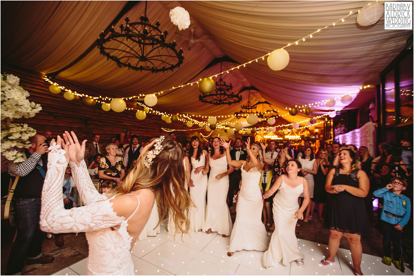 Throwing the bouquet at Hornington Manor, Wedding band at Hornington Manor, Hornington Manor Wedding Photography, Hornington Manor Wedding Photographer, Yorkshire Wedding, Yorkshire Wedding Photographer, York Luxury Barn Wedding Venue, Yorkshire farmhouse Wedding Barn