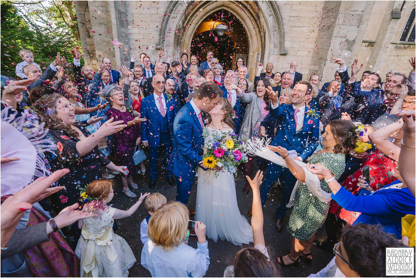 Wedding photos of confetti St Matthews Chapel Allerton, Wedding reception photos at Lineham Farm near Eccup and Arthington on the outskirts of Leeds by Yorkshire Wedding Photographer Barnaby Aldrick