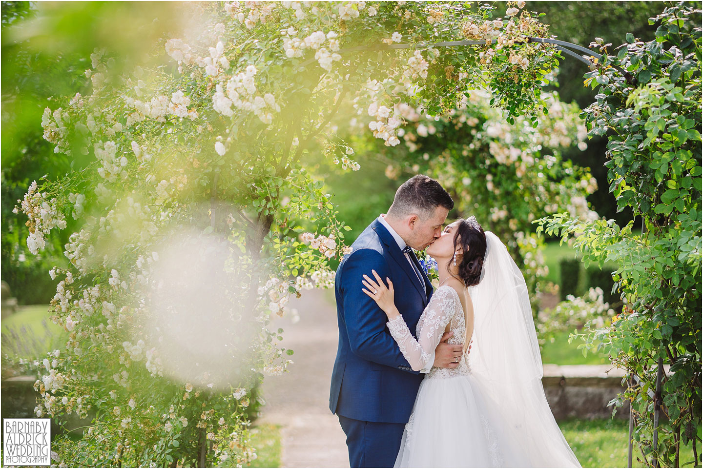 Wood Hall wetherby bride and groom kissing portrait