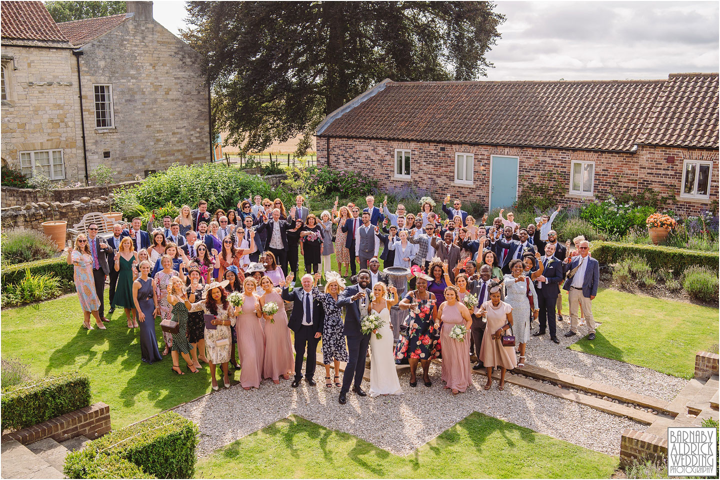 A group photo of everyone at Priory Cottages in Yorkshire, Wedding photos at Priory Cottages, Wedding at The Priory Yorkshire